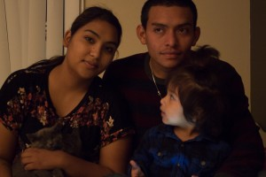 Jaritza Hernandez, her husband and Alexa pose for a family picture in their apartment. After being homeless for six months, the family is very happy to have a home of their own where Alexa can run around and play and be safe.