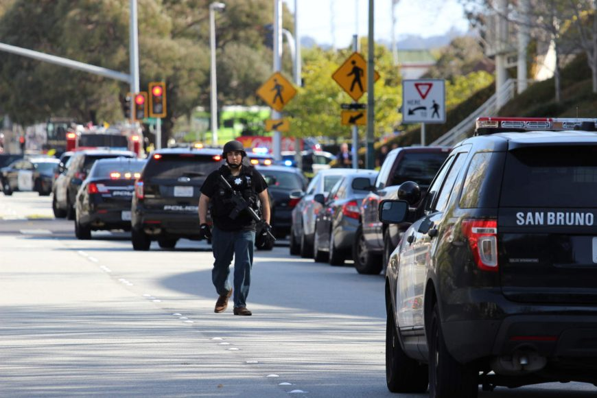 A police officer patrols the scene outside the YouTube headquarters in San Bruno on Tuesday, April 3, 2018. (Anthony Miller/Peninsula Press)