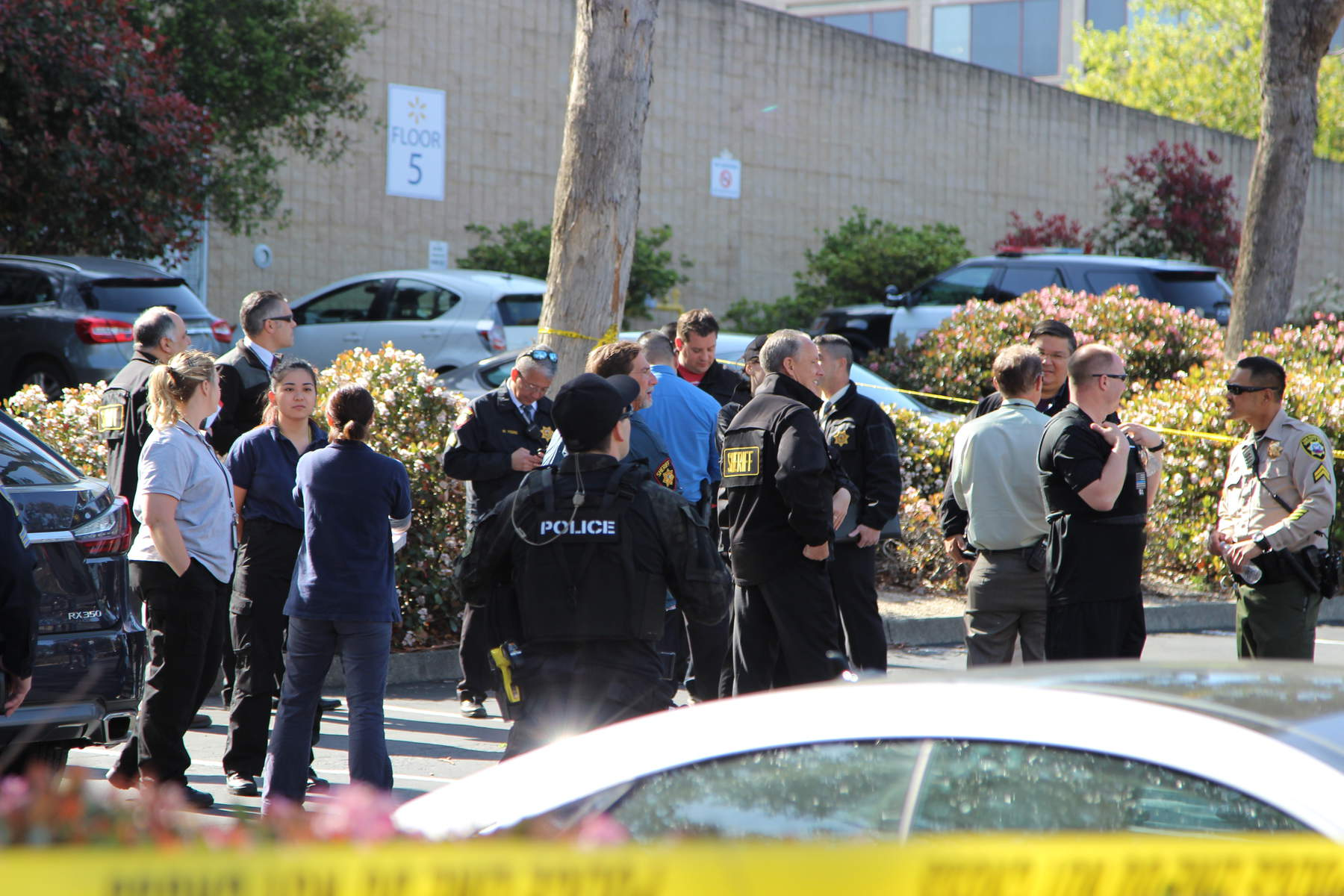 Law enforcement officials gather near the scene of the shooting at the YouTube headquarters in San Bruno on Tuesday, April 3, 2018. (Dylan Freedman/Peninsula Press)