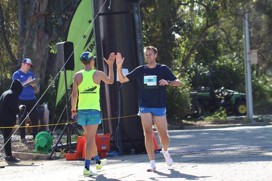 High fives for the first two finishers of the 5k run.