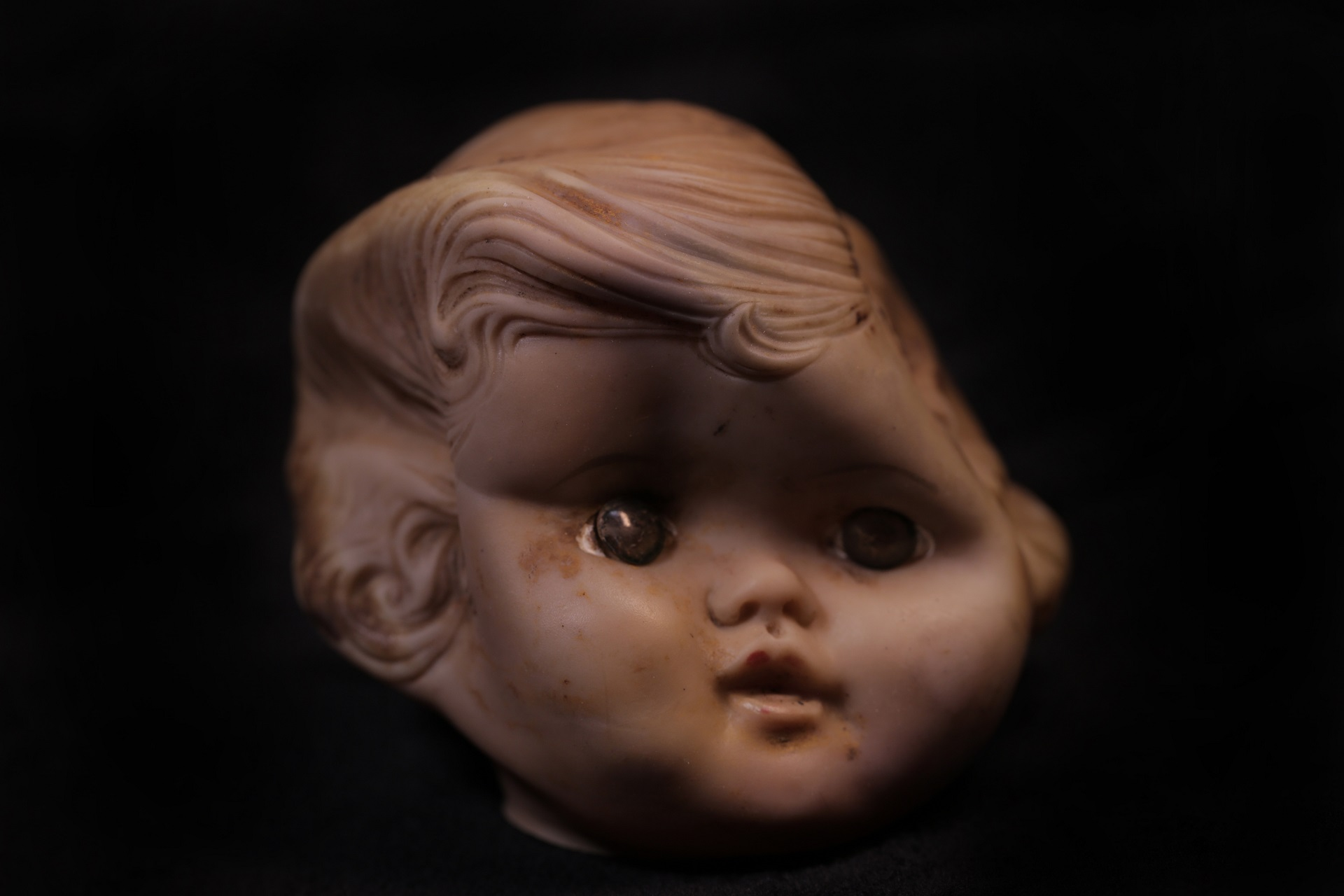 A doll's head found at the site of the old landfill. (Jackie Botts/Peninsula Press)