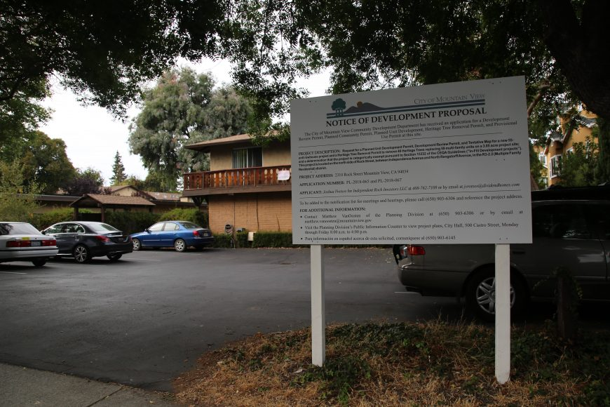 A sign sits in front of 2310 Rock Street, Mountain View, California, on Sunday, Sept. 30, 2018. It displays information on a new developmental proposal for the site that would displace current residents in an effort to construct a new 55-unit rowhouse project. (Melanie Hogue/Peninsula Press)