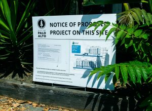 """A Sign on the corner of El Camino Real and Wilton Avenue in Palo Alto, detailing the proposed Wilton Court Project, an initiative of """"Palo Alto Housing"""", the affordable housing non-profit."""
