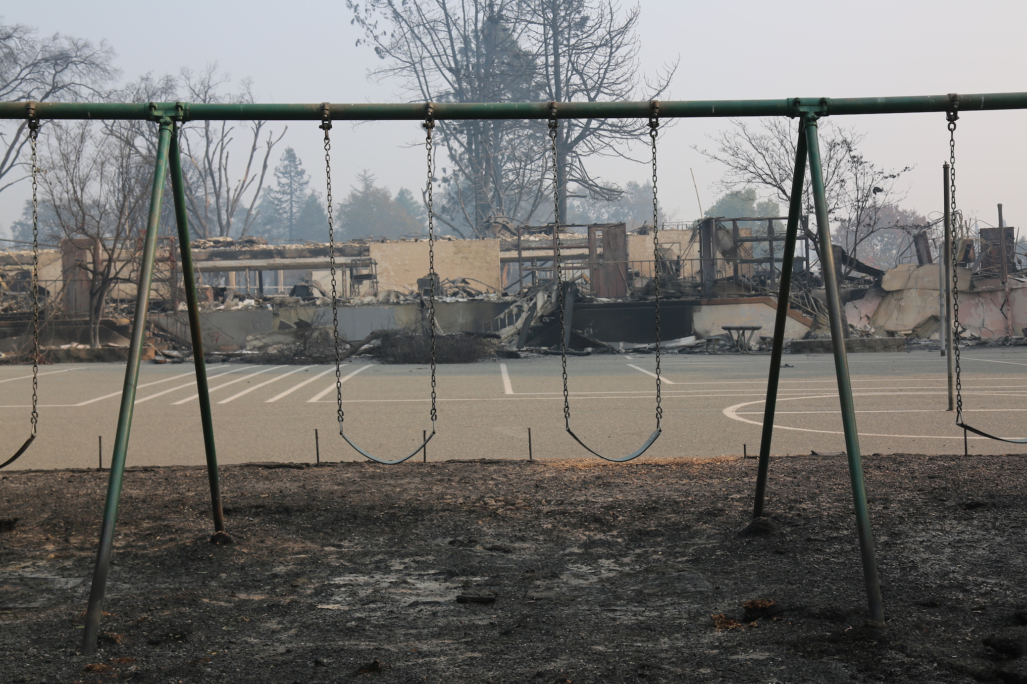 Metal swing sets and monkey bars survived the blaze, but Paradise Elementary's surrounding buildings did not.  Isabella Jibilian/Peninsula Press