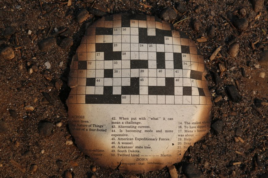 The burned remnant of a crossword puzzle, flecked with ash, found on Paradise Elementary School grounds. Isabella Jibilian/Peninsula Press