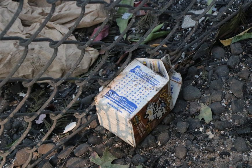 A child's chocolate milk carton was left near the fence bordering Paradise Elementary, which burned down due to the Camp Fire.  Ashlyn Rollins/Peninsula Press