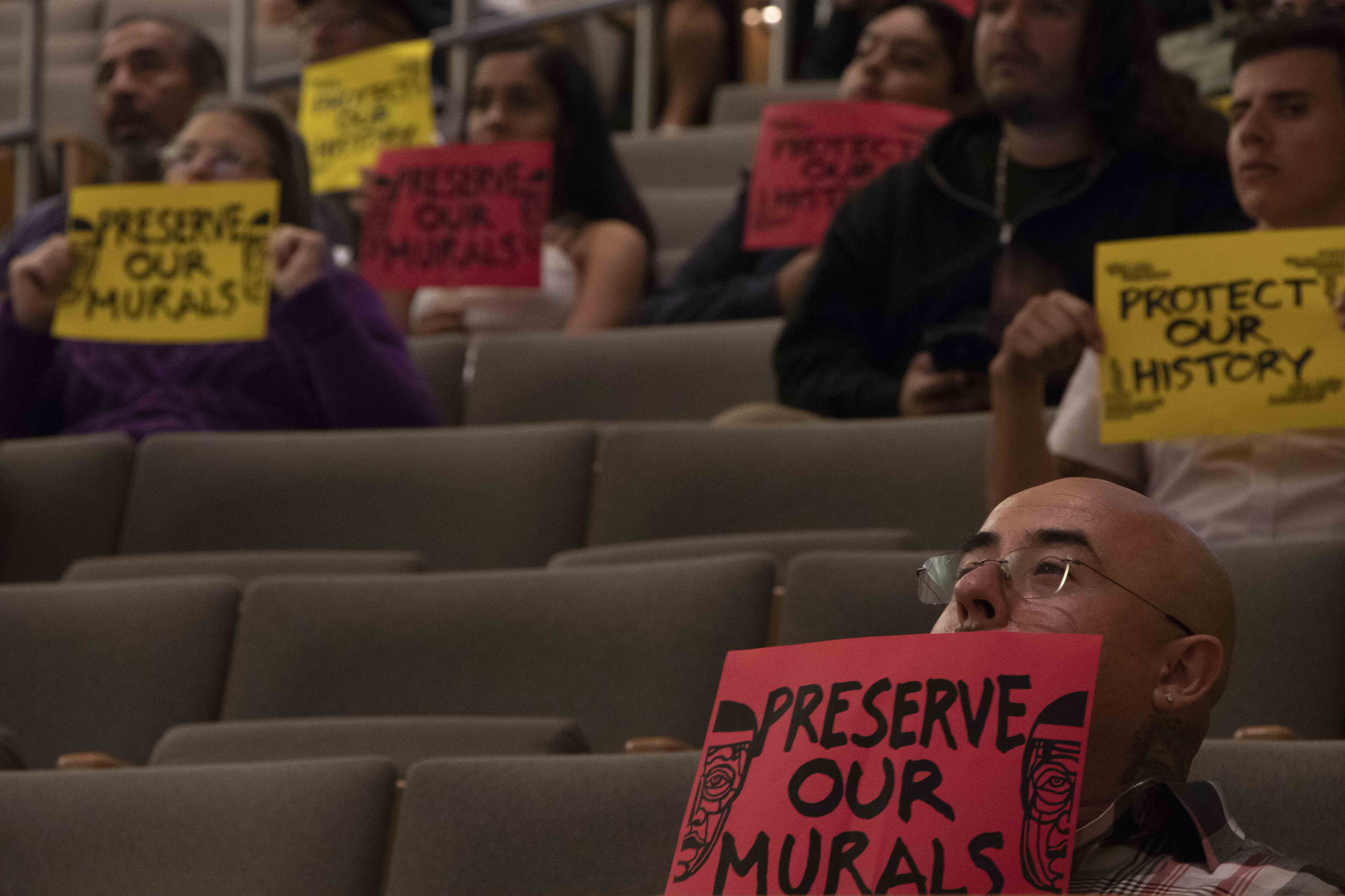 Residents hold up signs during a Historic Landmarks Commission meeting in San Jose, Calif., on Wednesday, Oct. 2, 2019. (Vanessa Ochavillo/Peninsula Press)