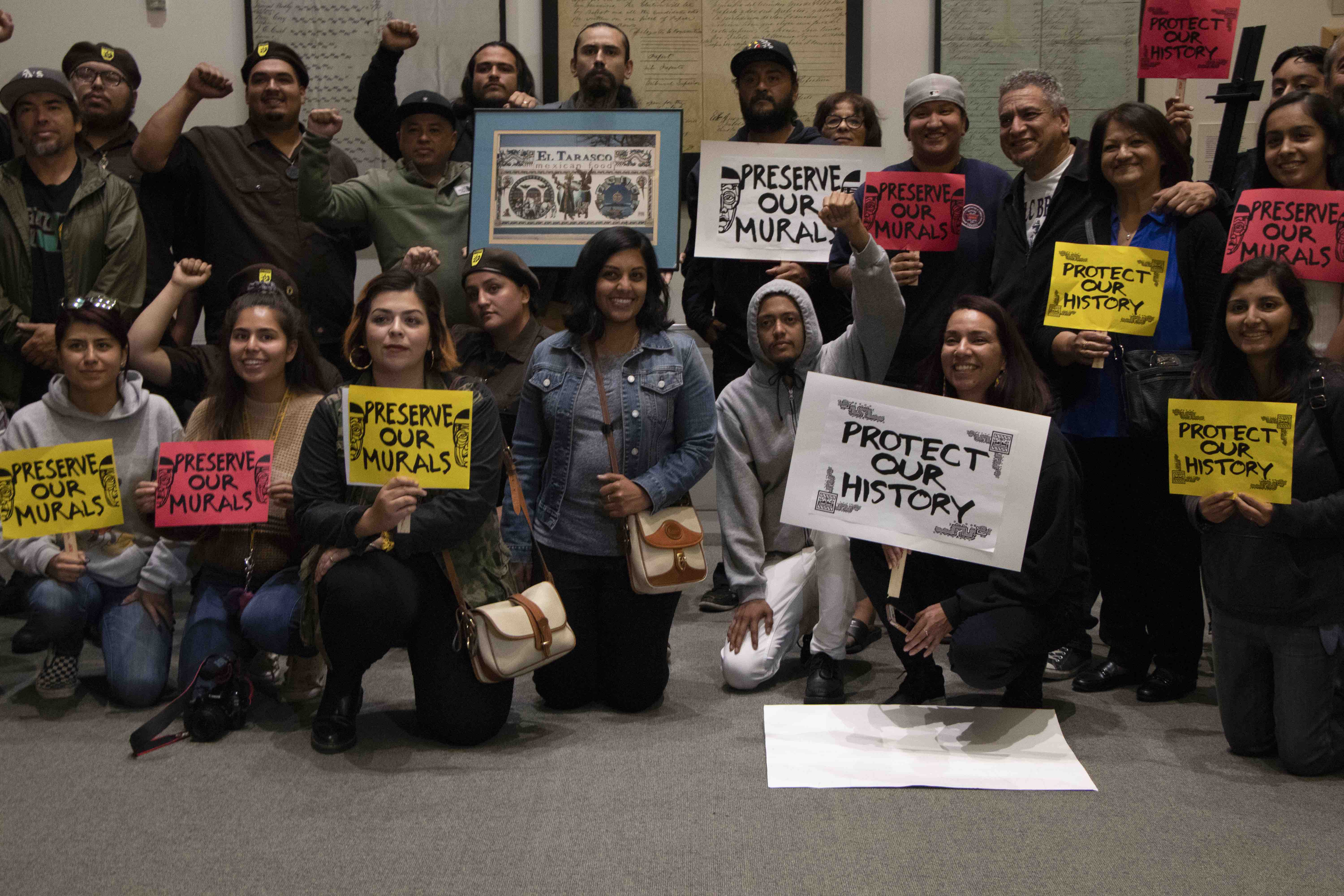 Members of the grassroots organization El Comité for the Preservation of Chicano Arts after successfully advocating for the protection of Chicano murals at the Historic Landmarks Commission meeting in San Jose, Calif., on Wednesday, Oct. 2, 2019. (Vanessa Ochavillo/Peninsula Press)