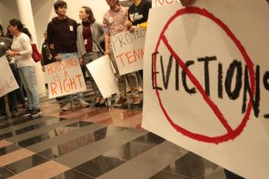 Tenants, faith leaders and tenants rights advocates gather in city hall in Redwood City, Calif.