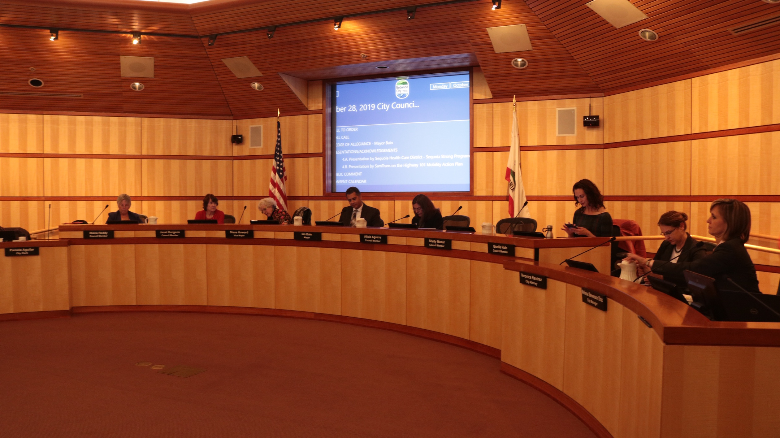 Redwood City Councilmembers prepare for a meeting to discuss an ordinance capping rent increases and setting just-cause eviction protections on Monday, Oct. 28, 2019. Tenants advocates in California say they've seen a wave of evictions and rent hikes in anticipation of Assembly Bill 1482. (Amy DiPierro / Peninsula Press)