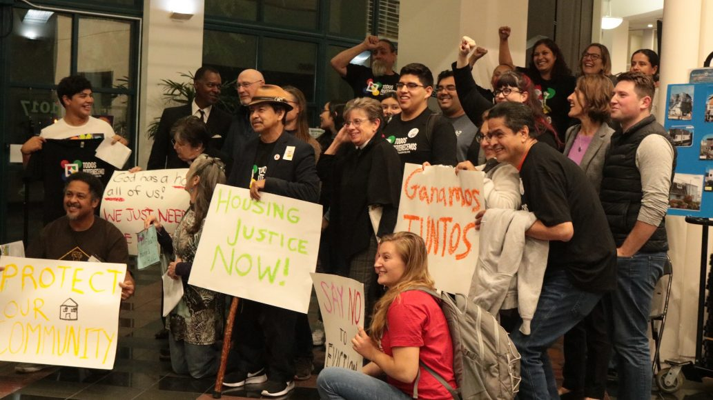 Tenants, faith leaders and tenant advocates celebrate the passage of an ordinance capping rent increases and setting just-cause eviction protections at city hall in Redwood City, Calif. on Monday, Oct. 28, 2019. Tenants advocates in California say they've seen a wave of evictions and rent hikes in anticipation of Assembly Bill 1482. (Amy DiPierro / Peninsula Press)