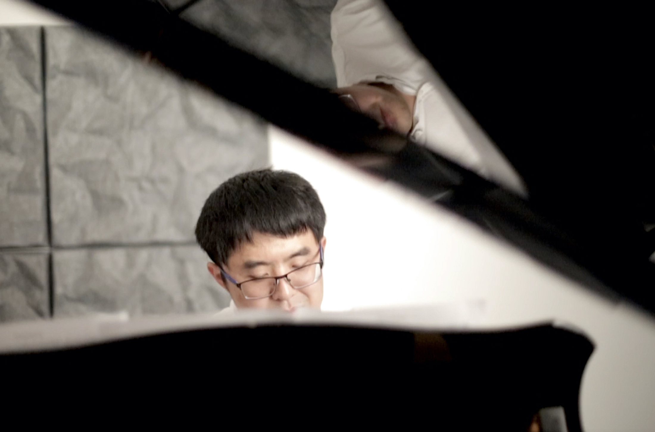 """Yi Yin, 37, plays the piano in a music studio in Palo Alto, on Monday, October 14, 2019. Yin composes the piano piece, which he names after the protest, """"September 26th Piano Sonata"""". (Qian Chen/Peninsula Press)"""