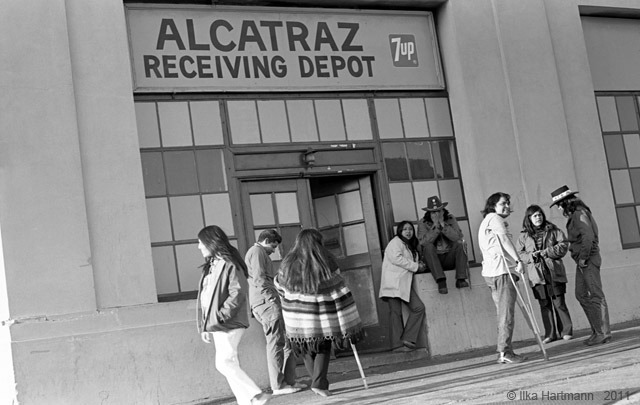 A group of Indian people at Pier 40 following the June 11, 1971 removal from Alcatraz. John Trudell (right) wears a hat. (Courtesy of Ilka Hartmann)