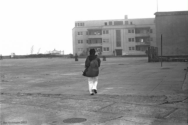 The fog comes in over Alcatraz. An Indian woman walks toward the Ira Hayes House on the lower level of the island. On her jacket is says Alcatraz Sioux. Alcatraz Island, May, 1970.  (Courtesy of Ilka Hartmann)