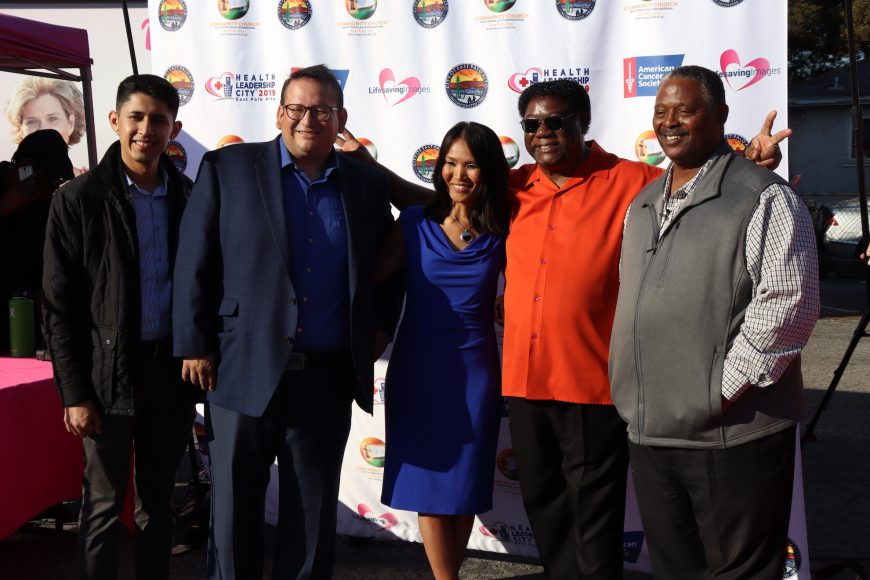 Representatives from Life Saving Images, East Palo Alto city council and Community Church of East Palo Alto pose during the launch of the mobile screening clinic in East Palo Alto, Calif., Wednesday, Nov. 6, 2019. (Astrid Casimire/Peninsula Press)