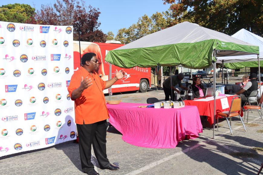 Pastor Ervin Wilson of the Community Church of East Palo Alto addresses the media at the launch of the mobile screening clinic, an initiative of Life Saving Images Inc and the American Cancer Society. (Astrid Casimire/Peninsula Press)