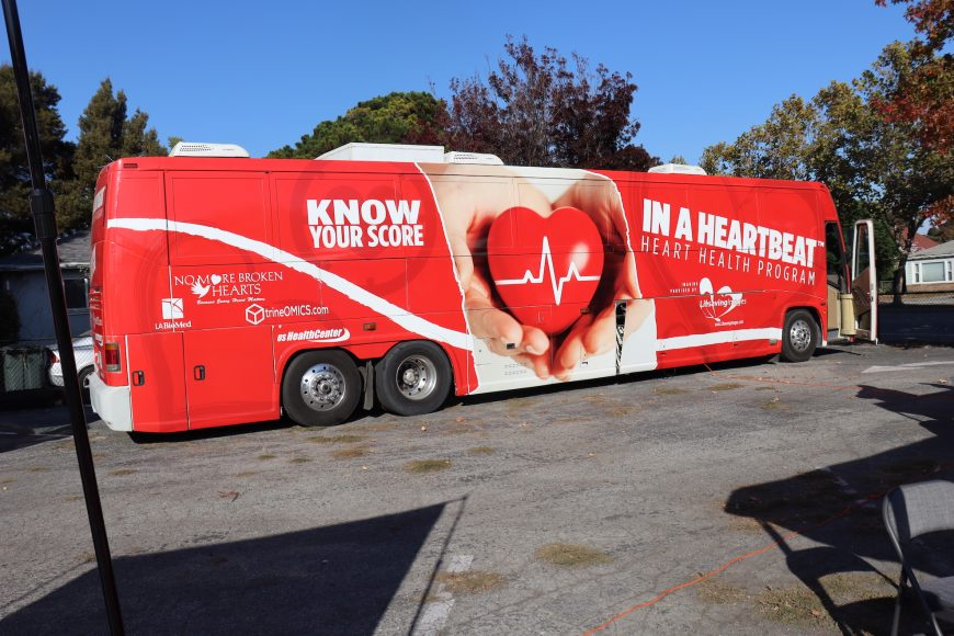 A red mobile heart-screening unit is stationed at the Community Church of East Palo Alto during the launch of a four-day health screening clinic by Life Saving Images Inc and the American Cancer Society (Astrid Casimire/Peninsula Press)