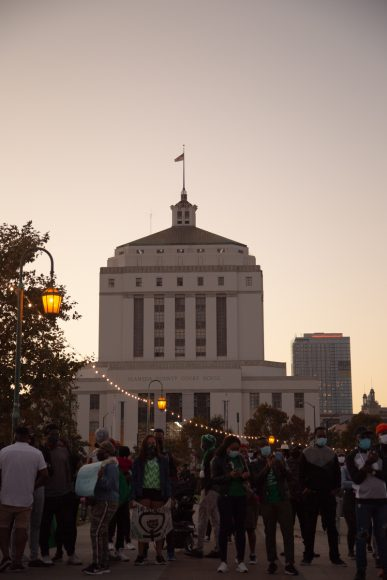 The sun sets over the Alameda County Courthouse in Oakland, Calif., Saturday, Oct. 24, 2020. The #endSARS protest in Oakland ended with prayer. (Noah Cortez, Peninsula Press)