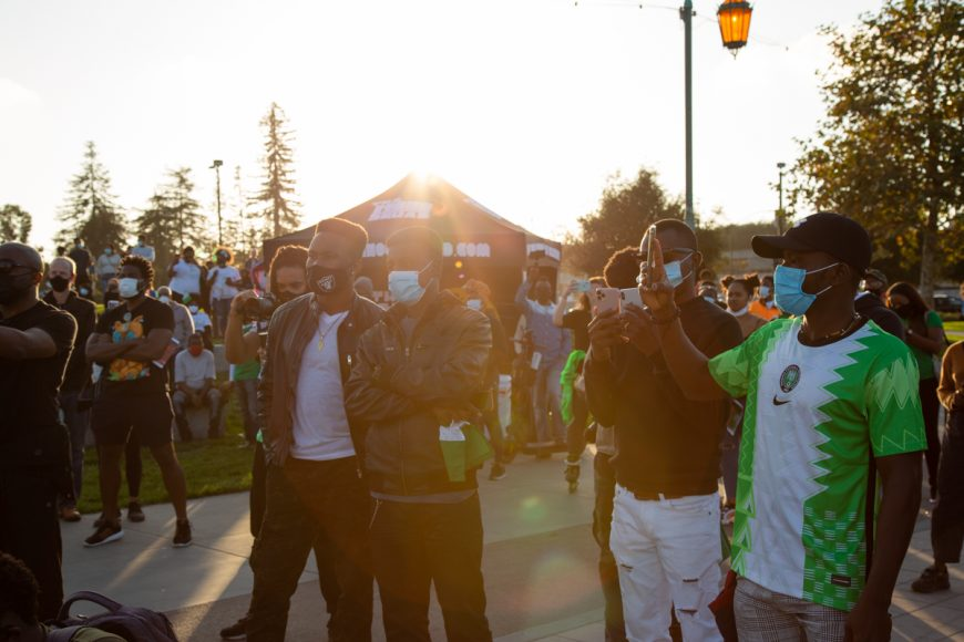 A group of young men at the #endSARS protest in Oakland, Calif., Saturday, Oct. 24, 2020. (Noah Cortez, Peninsula Press)