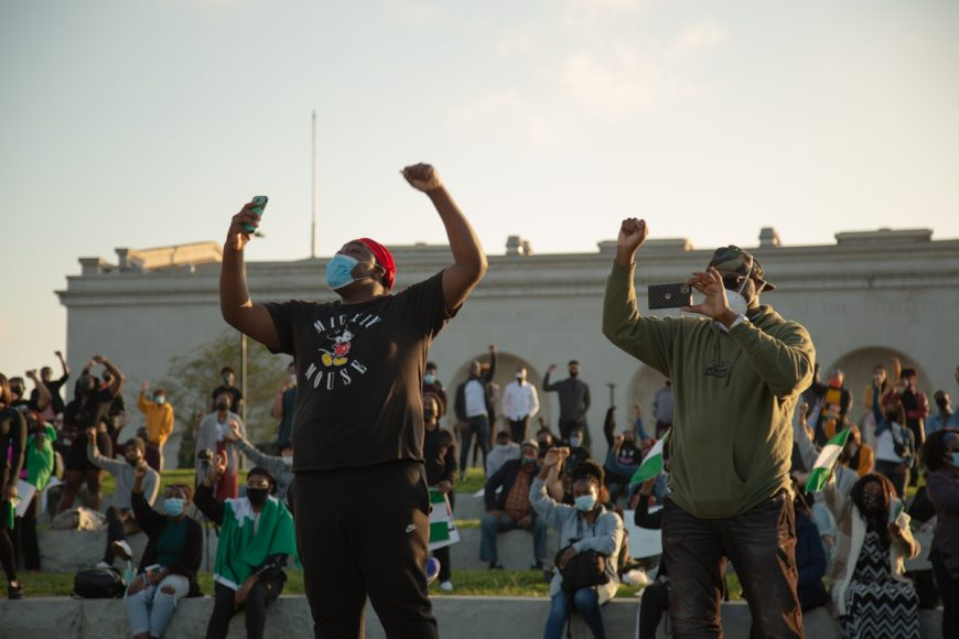Protestors stand in solidarity against SARS during a protest in Oakland, Satuday, Oct. 24, 2020. SARS, or Special Anti-Robbery Squad, is a police unit in Nigeria that have been scrutinized for becoming reckless with corruption. (Noah Cortez, Peninsula Press)