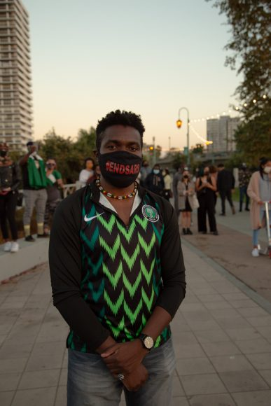 Kris Francis poses for a photo at the #endSARS protest in Oakland, Calif., Oct. 24, 2020. (Noah Cortez, Peninsula Press)