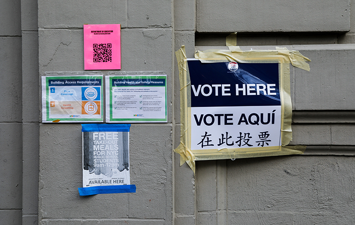 Signs direct voters to the poll center located at St. Luke's School in the West Village. (Iman Floyd-Carroll/Peninsula Press)