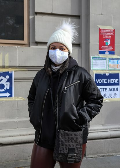 """Dara Tsoroni, a NYC local and immigration lawyer proudly exits the polls after casting her ballot in favor of former Vice President Joe Biden at St. Luke's School in the West Village. Dara Tsoroni reflects on how President Trump's policies have impacted her work. """"There were policies we could previously work around, but now the absolute most cruel option is always the reality."""" (Iman Floyd-Carroll/Peninsula Press)"""