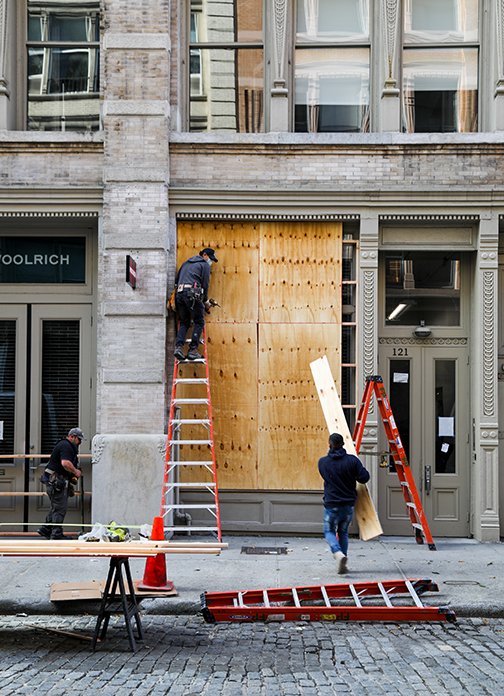 Workers board up the Ted Baker storefront located in SoHo, Manhattan in anticipation of possible post-election incidents of looting. (Iman Floyd-Carroll/Peninsula Press)