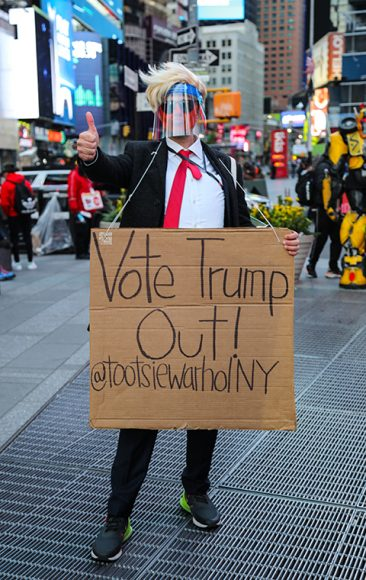 A caricature of President Trump joins the gaggle of characters, both fictional and otherwise, attracting the eyes of passers-by in Times Square on Nov. 3. (Iman Floyd-Carroll/Peninsula Press)