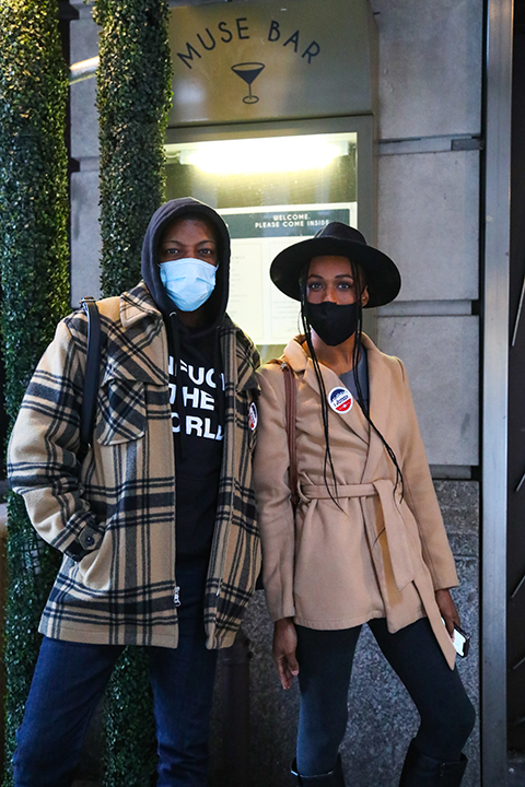 """Shakeem (identified by first name only) and Aalia Cox leave the polls at Times Square proudly sporting """"I Voted"""" stickers. (Iman Floyd-Carroll/Peninsula Press)"""