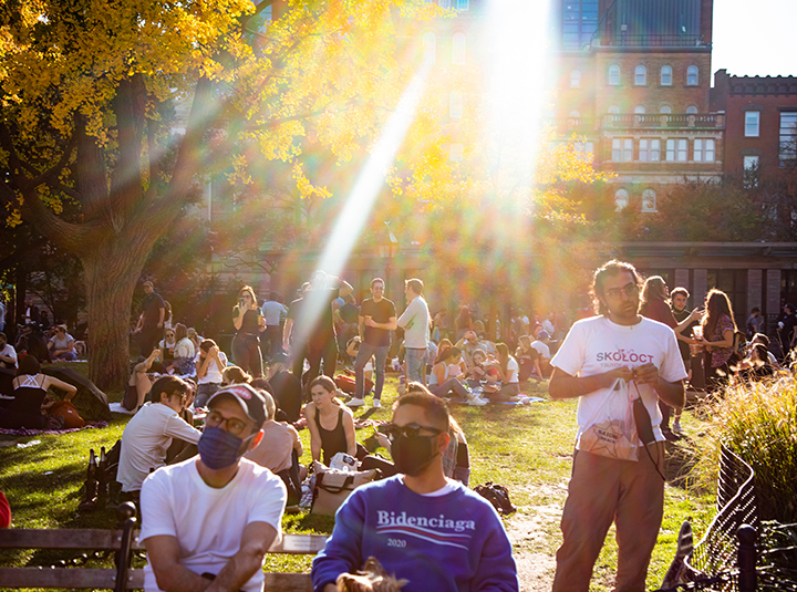 Marked by unusually warm 72 degree weather for November, thousands gathered at Washington Square Park on Nov. 8 to picnic and share in the communal joy marked by President-elect Joseph R. Biden Jr. and Kamala Harris' historic victory. (Iman Floyd-Carroll/Peninsula Press)