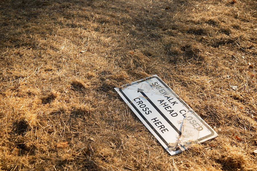 A sign on the ground near Enchanted Broccoli Forest at Stanford University. (Noah Cortez, Peninsula Press)