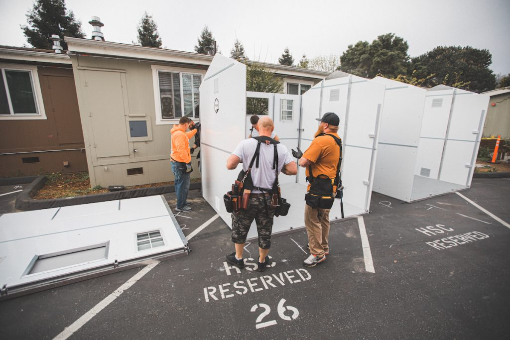 Workers assemble prefabricated housing units at Housing Matters' Coral Street facility in April. (Photo courtesy of Housing Matters).