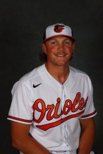 A baseball player smiles at the camera