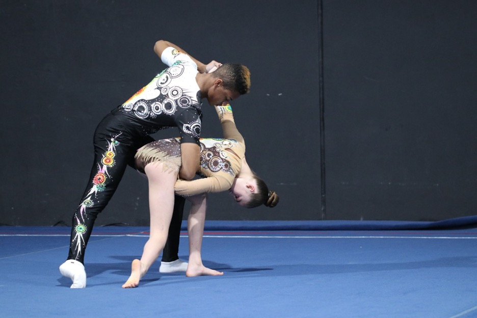 """Amaya Rogers and Jaylen Ivey perform their dynamic routine. Acro includes """"dynamic,"""" """"balance,"""" and """"combination"""" routines.  (Jasmine Kerber/Peninsula Press)"""