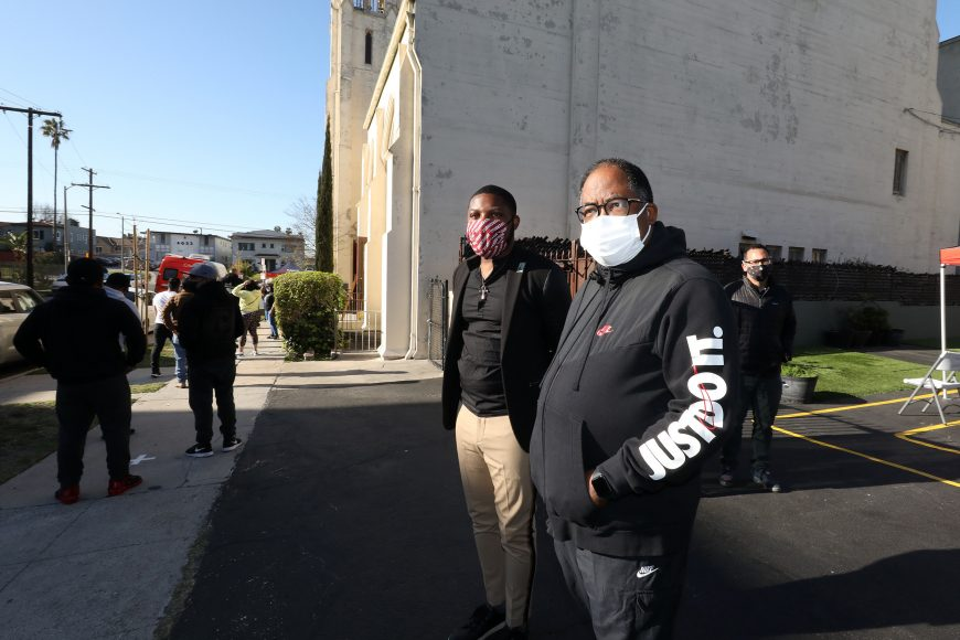Pastor Eddie Anderson (left) speaks with City Councilmember Mark Ridley-Thomas at the Inclusive Action vaccination event. (Photo courtesy of McCarty Memorial Christian Church.)