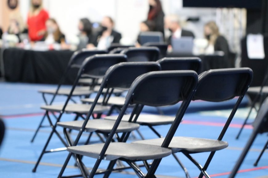 The audience area sits empty during the virtual portion of the competition, but the judges are busy at work evaluating videos of routines. (Jasmine Kerber/Peninsula Press)