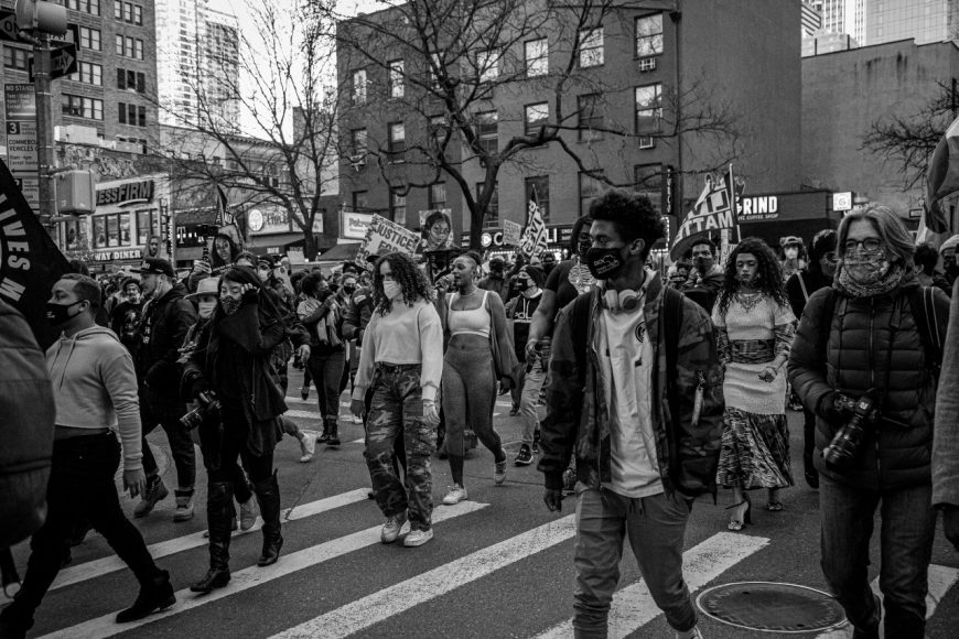 A large and diverse group of protesters turns off Ninth Ave. and heads down 43rd Street at the Justice for Breonna Taylor march on March 13, 2021. (Iman Floyd-Carroll/Peninsula Press )