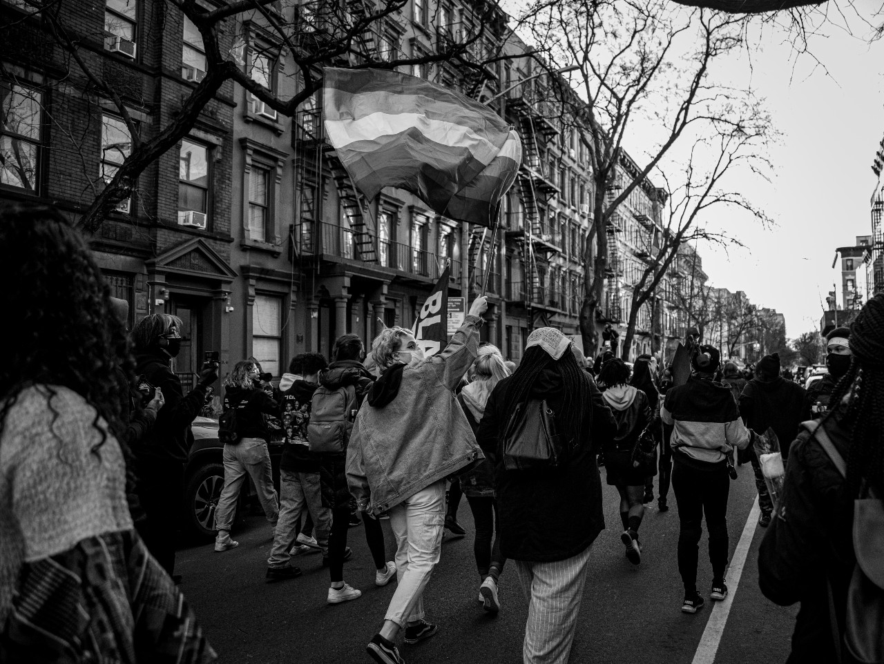 A group of protesters march towards the Westside Highway carrying pride and Black Lives Matter flags on March 13, 2021. (Iman Floyd-Carroll/Peninsula Press )